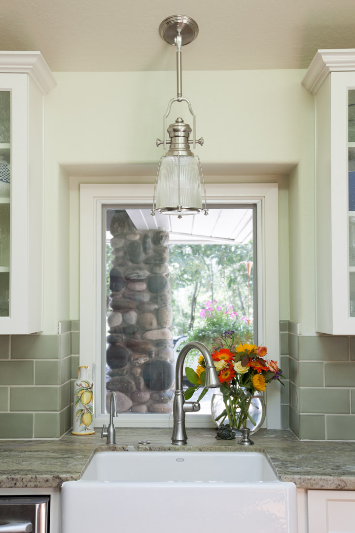 This subtle greens of the wall, tile, and countertop all blend in harmoniously.